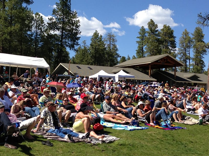 Concert goers enjoy Pepsi Amphitheater at Fort Tuthill Park on a sunny day